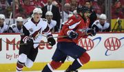 Washington Capitals left wing Alex Ovechkin (8) takes off down ice watched by Arizona Coyotes defenseman Connor Murphy (5) during an NHL hockey game Saturday, March 25, 2017, in Washington. (AP Photo/Molly Riley)