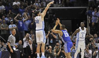 North Carolina forward Luke Maye (32) shoots the winning basket as Kentucky guard Isaiah Briscoe (13) defends in the second half of the South Regional final game in the NCAA college basketball tournament Sunday, March 26, 2017, in Memphis, Tenn. The basket gave North Carolina a 75-73 win. (AP Photo/Brandon Dill)