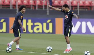 Brazil's Neymar, right, and Marcelo, attend a training session in Sao Paulo, Brazil, Saturday, March 25, 2017. Brazil will face Paraguay in a 2018 World Cup qualifying soccer match on March 28. (AP Photo/Andre Penner)