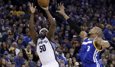 Memphis Grizzlies' Zach Randolph (50) shoots over Golden State Warriors' David West (3) during the first half of an NBA basketball game Sunday, March 26, 2017, in Oakland, Calif. (AP Photo/Marcio Jose Sanchez)