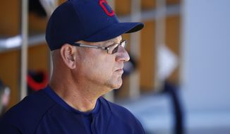 Cleveland Indians manager Terry Francona pauses in the dugout prior to the team's spring training baseball game against the Chicago Cubs Friday, March 24, 2017, in Mesa, Ariz. The Indians defeated the Cubs 4-2. (AP Photo/Ross D. Franklin)