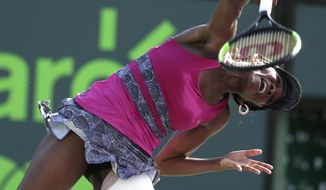Venus Williams, of the United State, serves to Patricia Maria Tig, of Romania, during the Miami Open tennis tournament, Sunday, March 26, 2017, in Key Biscayne, Fla. Williams won 6-3, 6-0. (AP Photo/Lynne Sladky)