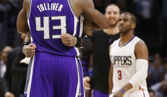 Sacramento Kings center Willie Cauley-Stein celebrates with forward Anthony Tolliver (43) after scoring the go-ahead basket in an NBA basketball game while Los Angeles Clippers guard Chris Paul, right, walks behind them Sunday, March 26, 2017, in Los Angeles. (AP Photo/Danny Moloshok)