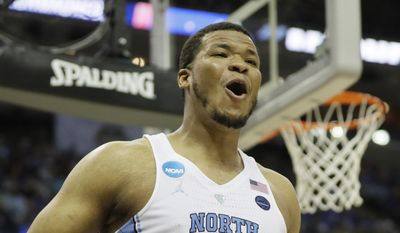 North Carolina forward Kennedy Meeks (3) reacts to play under the basket against Kentucky in the first half of the South Regional final game in the NCAA college basketball tournament Sunday, March 26, 2017, in Memphis, Tenn. (AP Photo/Mark Humphrey)