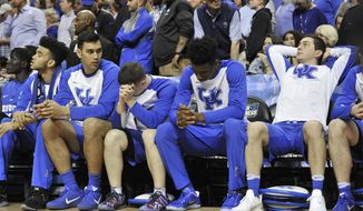 Kentucky players react to a score by North Carolina's Luke Maye that gave North Carolina a 75-73 win in the final seconds of the South Regional final game in the NCAA college basketball tournament Sunday, March 26, 2017, in Memphis, Tenn. (AP Photo/Brandon Dill)