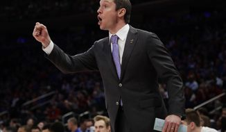 Florida head coach Mike White motions to players during the first half of the East Regional championship game against South Carolina during the NCAA men's college basketball tournament, Sunday, March 26, 2017, in New York. (AP Photo/Frank Franklin II)