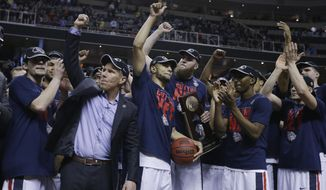 Gonzaga players and head coach Mark Few, second from left, celebrate after beating Xavier during an NCAA Tournament college basketball regional final game Saturday, March 25, 2017, in San Jose, Calif. (AP Photo/Ben Margot)