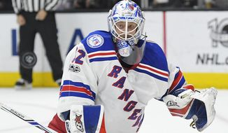 New York Rangers goalie Antti Raanta, of Finland, deflects a shot during the second period of the team's NHL hockey game against the Los Angeles Kings, Saturday, March 25, 2017, in Los Angeles. (AP Photo/Mark J. Terrill)