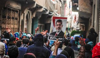 In 2011, the Muslim Brotherhood briefly was elected democratically to power in Egypt before its leader, Mohammed Morsi, was ousted from power. (Associated press)