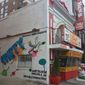 A temporary mural was painted on the side of Ben's Chili Bowl on U Street directing people to the restaurant's website, where they can vote for famous politicians, athletes and entertainers to be featured in the new mural. (Julia Brouillette/The Washington Times)