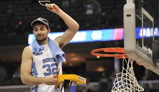 North Carolina forward Luke Maye (32) cuts down the net after North Carolina beat Kentucky in the South Regional final game in the NCAA college basketball tournament Sunday, March 26, 2017, in Memphis, Tenn. Maye shot the winning basket that gave North Carolina a 75-73 win. (AP Photo/Brandon Dill)