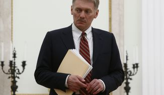 "Kremlin spokesman Dmitry Peskov attends a meeting between Russian President Vladimir Putin and Serbian Prime Minister Aleksandar Vucic at the Kremlin in Moscow, Russia, Monday March 27, 2017. Peskov defended the Russian police in riot gear who were seen manhandling Sunday's protesters, some of whom were minors, calling their response ""highly professional and lawful."" (Sergei Karpukhin/Pool photo via AP)"