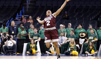 Mississippi State's Morgan William (2) celebrates at the conclusion of the regional final of the NCAA women's college basketball tournament against Baylor, Sunday, March 26, 2017, in Oklahoma City. Mississippi State won 94-85. (AP Photo/Alonzo Adams)