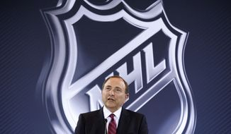 FILE - In this June 22, 2016, file photo, NHL Commissioner Gary Bettman speaks during a news conference  in Las Vegas. The NHL is eyeing opportunities to crack the biggest market in the world: China. With the 2022 Olympics in Beijing following 2018 in Pyeongchang, the NHL and NHLPA see the country of a billion people as hockey's next frontier. (AP Photo/John Locher, File)