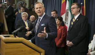 "FILE - In this March 6, 2017 file photo, North Carolina Lt. Gov. Dan Forest, left, center, talks about his state's ""bathroom bill,"" at the Capitol in Austin, Texas. Texas Lt. Gov. Dan Patrick. right, looks on. Forest is a strong supporter of the bill. He has accused news organizations of creating a false picture of economic upheaval. The Associated Press has determined that North Carolina's law limiting LGBT protections will cost the state more than $3 billion in lost business over a dozen years. (Deborah Cannon, Austin American-Statesman, File)   /Austin American-Statesman via AP)"