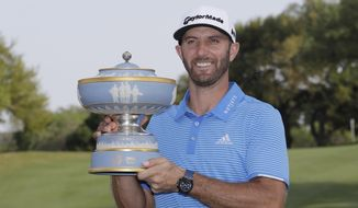 Dustin Johnson poses with his trophy after defeating Jon Rahm, of Spain, at the Dell Technologies Match Play golf tournament at Austin County Club, Sunday, March 26, 2017, in Austin, Texas. (AP Photo/Eric Gay)