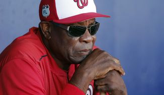 In this March 11, 2017, file photo, Washington Nationals manager Dusty Baker (12) talks to reporters in the dugout before playing New York Mets in a spring training baseball game, in Port St. Lucie, Fla. (AP Photo/John Bazemore, File)