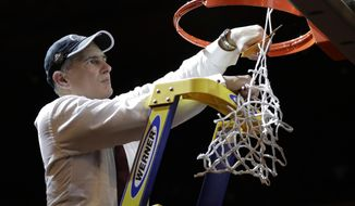 South Carolina head coach Frank Martin cuts down the net after beating Florida 77-70 in the East Regional championship game of the NCAA men's college basketball tournament, Sunday, March 26, 2017, in New York. (AP Photo/Julio Cortez)