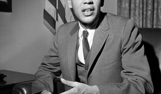 FILE - In a Dec. 27, 1965 file photo, Roger W. Wilkins speaks, in Washington. Wilkins, the historian, journalist and activist who held a key civil rights post in the Johnson administration, died Sunday,, March 27, 2017, at an assisted-living facility in Kensington, Md., said his wife, Patricia King. He was 85. (AP Photo/Charles Tasnadi, File)
