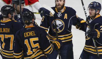 Buffalo Sabres forward Ryan O'Reilly (90) celebrates his goal with teammates during the first period of an NHL hockey game against the Florida Panthers, Monday, March 27, 2017, in Buffalo, N.Y. (AP Photo/Jeffrey T. Barnes)