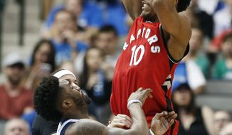 Toronto Raptors guard DeMar DeRozan (10) battles Dallas Mavericks guards Wesley Matthews, left foreground, and Seth Curry, background, for space during the second half of an NBA basketball game Saturday, March 25, 2017, in Dallas.  (AP Photo/Brandon Wade)