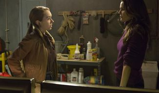 """In this image released by FX, Holly Taylor portrays Paige Jennings, left, and Keri Russell portrays Elizabeth Jennings in a scene from """"The Americans,"""" airing Tuesdays at 10 p.m. EDT. (Patrick Harbron/FX via AP)"""