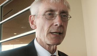 FILE - In this March 15, 2017, file photo, Wisconsin school Superintendent Tony Evers talks with reporters in Madison, Wis. Superintendent Evers continues to far outpace challenger Lowell Holtz in fundraising with the April 4 election just a week away. (AP Photo/Scott Bauer, File)