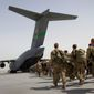 U.S. soldiers walk to get in to a U.S. military plane, as they leave Afghanistan, at the U.S. base in Bagram, north of Kabul, Afghanistan on July 14, 2011. (Associated Press) **FILE**