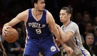 Brooklyn Nets' Jeremy Lin (7) defends Philadelphia 76ers' Dario Saric (9) during the second half of an NBA basketball game Tuesday, March 28, 2017, in New York. The 76ers won 106-101. (AP Photo/Frank Franklin II)