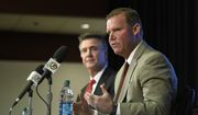 Scot McCloughan, right, speaks during an NFL football press conference where he was introduced as the Washington Redskins new general manager, Friday, Jan. 9, 2015, in Ashburn, Va. At left is Washington Redskins president Bruce Allen. (AP Photo/Nick Wass)