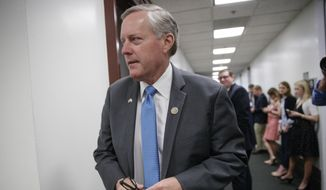 House Freedom Caucus Chairman Rep. Mark Meadows, R-N.C., whose conservative GOP members derailed the Republican health care bill, leaves a closed-door strategy session with Speaker of the House Paul Ryan, R-Wis., and the leadership as they try to rebuild unity within the Republican Conference, at the Capitol, in Washington, Tuesday, March 28, 2017. (AP Photo/J. Scott Applewhite)