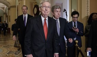 Senate Majority Leader Mitch McConnell of Ky., joined by Sen. John Thune, R-S.D., left rear, and Sen. Roy Blunt, R-Mo., right, arrives to speak with reporters following a closed-door strategy session, Tuesday, March 28, 2017, on Capitol Hill in Washington. (AP Photo/J. Scott Applewhite)