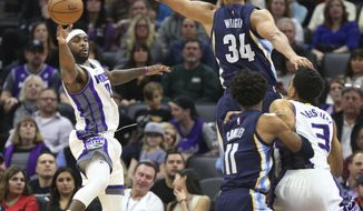 Sacramento Kings guard Ty Lawson (10) passes the ball against Memphis Grizzlies defender Brandan Wright (34) during the first half of an NBA basketball game in Sacramento, Calif., Monday, March. 27, 2017. (AP Photo/Steve Yeater)