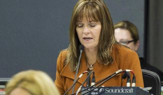 "In this Nov. 15, 2015 photo, Geri Huser, chairwoman of the Iowa Utilities Board, speaks during a hearing on the Dakota Access pipeline at the Boone County Fairgrounds in Boone, Iowa. A review by The Associated Press shows that Huser maintained a busy and profitable private legal practice even though a law mandates she devote her ""whole time"" to state business. (Jeff Brown/The Hawk Eye via AP)"