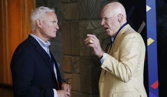 Houston Texans owner Bob McNair, right, talks with Cleveland Browns owner Jimmy Haslam, left, at the NFL football meetings Monday, March 27, 2017, in Phoenix. (AP Photo/Ross D. Franklin)