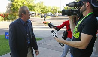 Los Angeles Chargers owner Dean Spanos arrives for the start of the NFL football annual meetings Sunday, March 26, 2017, in Phoenix. (AP Photo/Ross D. Franklin)