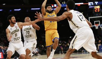 Cal State Bakersfield Justin Pride (51) looks to pass around the Georgia Tech defense during the second half of an NCAA college basketball game in the semifinals of the NIT Tuesday, March 28, 2017, in New York. (AP Photo/Kathy Willens)