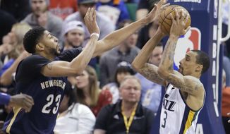 New Orleans Pelicans forward Anthony Davis (23) defends against Utah Jazz guard George Hill (3) during the first half in an NBA basketball game Monday, March 27, 2017, in Salt Lake City. (AP Photo/Rick Bowmer)