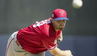 FILE - In this Feb. 24, 2017, file photo, Philadelphia Phillies starting pitcher Alec Asher warms up during a spring training baseball game against the New York Yankees in Tampa, Fla. The Baltimore Orioles have added another starting pitcher, acquiring right-hander Alec Asher from the Phillies on Tuesday, March 28, 2017, for a player to be named or cash.  The 26-year-old Asher was 2-7 with a 5.88 ERA in 12 big league starts for the Phillies in 2015 and 2016.  (AP Photo/Matt Rourke, File)