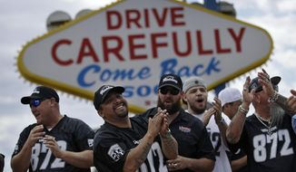 Members of a laborers union celebrate Monday, March 27, 2017, in Las Vegas. NFL team owners approved the move of the Raiders to Las Vegas in a vote at an NFL football annual meeting in Phoenix. (AP Photo/John Locher)