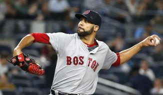 FILE - In this Sept. 27, 2016, file photo, Boston Red Sox starting pitcher David Price winds up during the second inning of the team's baseball game against the New York Yankees, in New York. Free agent pickup David Price had his struggles in the first year in Boston, including another disappointing playoff start. But he, too, showed flashes of why president of baseball operations Dave Dombrowski gave him a seven-year $217 million contract. (AP Photo/Kathy Willens, File)