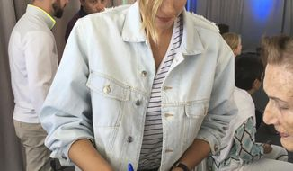 Maria Sharapova signs autographs at a sports conference as she nears the end of her 15-month doping suspension in Rancho Mirage, Calif., on Tuesday, March 28, 2017. The former No. 1 player plans to return to tennis next month at a tournament in Germany. (AP Photo/Greg Beacham)