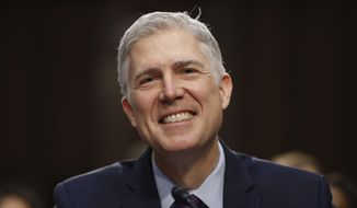 In this March 21, 2017, file photo, Supreme Court Justice nominee Neil Gorsuch smiles on Capitol Hill in Washington, during his confirmation hearing before the Senate Judiciary Committee. (AP Photo/Pablo Martinez Monsivais)