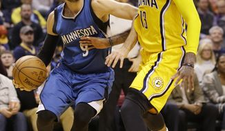 Minnesota Timberwolves guard Ricky Rubio (9) drives on Indiana Pacers forward Paul George (13) during the first half of an NBA basketball game in Indianapolis, Tuesday, March 28, 2017. (AP Photo/Michael Conroy)