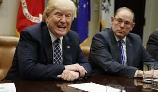 National Fraternal Order of Police President Chuck Canterbury listens at right as President Donald Trump speaks during a meeting with the Fraternal Order of Police, Tuesday, March 28, 2017, in the Roosevelt Room of the White House in Washington. (AP Photo/Evan Vucci)