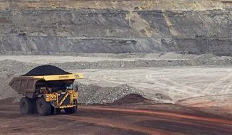 A dump truck hauls coal Tuesday, March 28, 2017, at Contura Energy's Eagle Butte Mine near Gillette, Wyo. President Donald Trump's lifting of a federal coal lease moratorium will allow new coal leasing to resume at the mine and others in the Powder River Basin that extract federally-owned coal. (AP Photo/Mead Gruver)