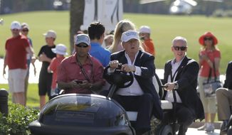FILE- In this March 6, 2016 file photo, Donald Trump drives himself around the golf course to watch the final round of the Cadillac Championship golf tournament in Doral, Fla. President Donald Trump's executive order seeking to rewrite a rule that protects small streams from pollution raises new questions about financial conflicts of interest for a president whose business holdings include a dozen U.S. golf courses. It's not clear whether any financial benefits from more lax regulation of waterways on golf courses could violate laws meant to keep politicians from using public office for personal gain, but experts say it adds to an appearance of impropriety.(AP Photo/Luis Alvarez, File)