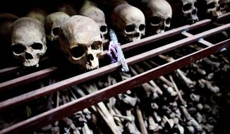 In this Sept. 27, 2009 photo, skulls and bones from some of the estimated 10,000 Tutsis killed in a two-day massacre at Nyamata church during the 1994 genocide, are displayed in a crypt behind the church, now a memorial to the genocide, in the town of Nyamata, Rwanda.           Associated Press photo