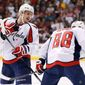 """Washington Capitals defensemen Dmitry Orlov (left) and Nate Schmidt made mistakes that turned them into healthy scratches last spring after being lineup mainstays in the regular season. Coach Barry Trotz called it """"next-level hockey."""" (Associated Press)"""