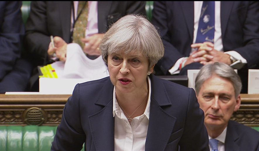 Britain's Prime Minister Theresa May speaks in the House of Commons in London in this image taken from video Wednesday March 29, 2017. May will announce to Parliament that Britain is set to formally file for divorce from the European Union Wednesday, ending a 44-year relationship, enacting the decision made by U.K. voters in a referendum nine months ago and launching both Britain and the bloc into uncharted territory. (Parliamentary Recording Unit via AP)